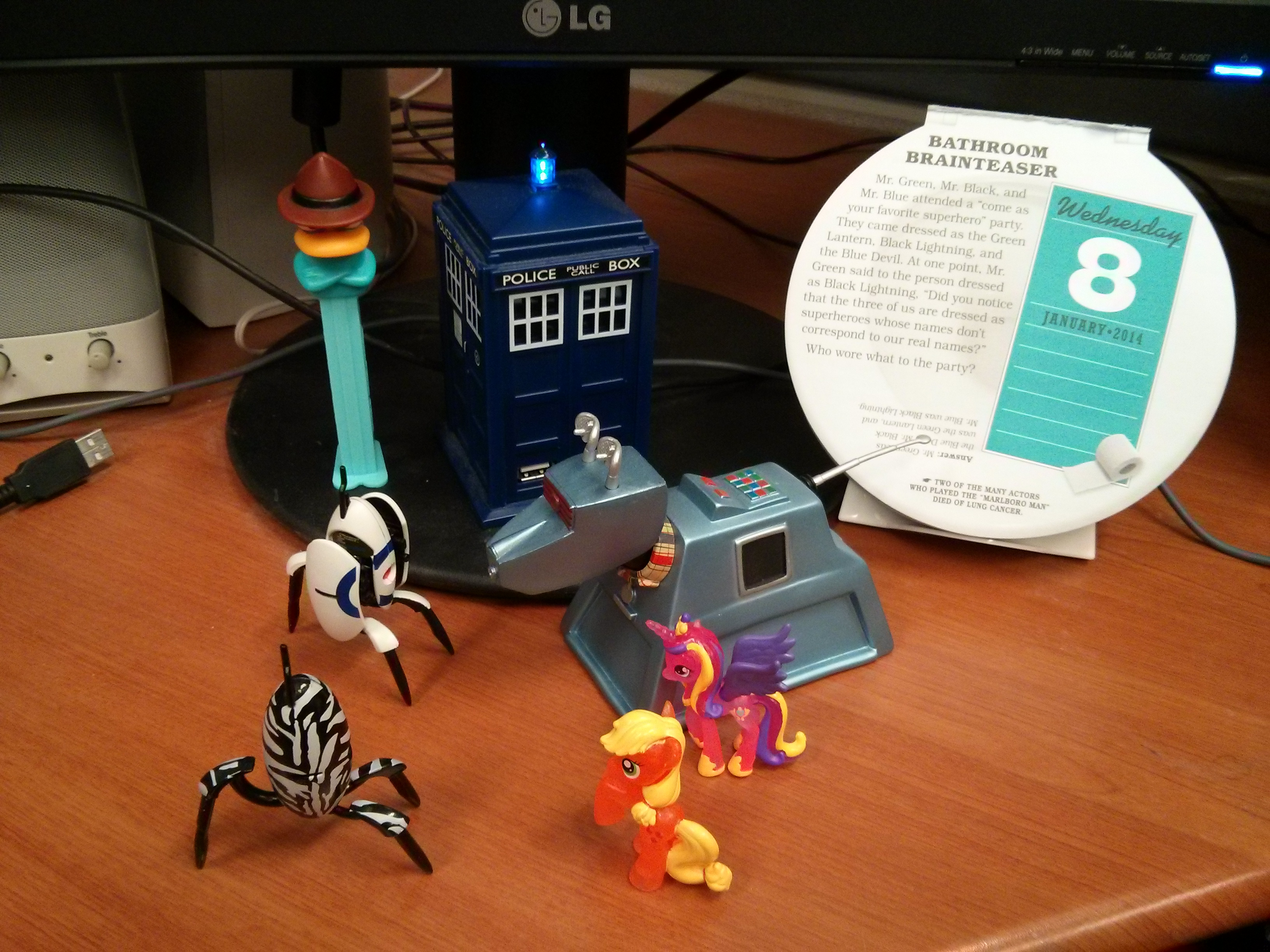 Agent P. Pez, Tardis USB hub, Uncle John's daily calendar, Two Portal Turrets, Princess Cadence, Crystal Applejack, and K9 Mark 2.