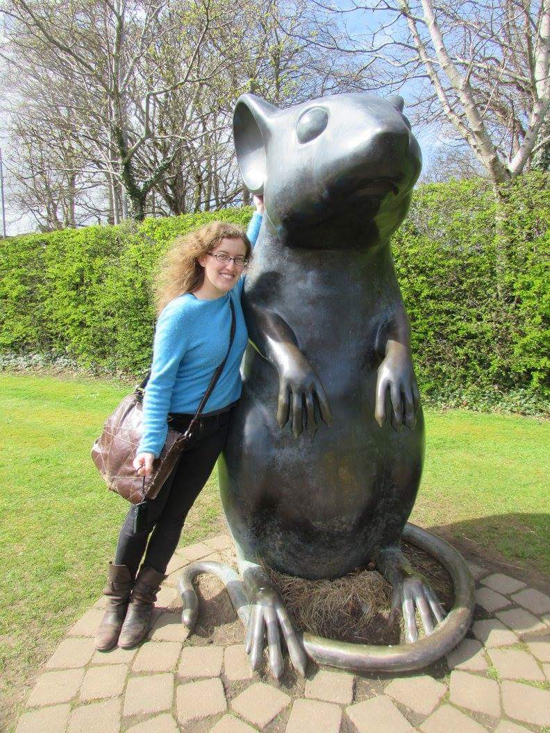 Karin with the mouse statue on the path at the Burns Museum